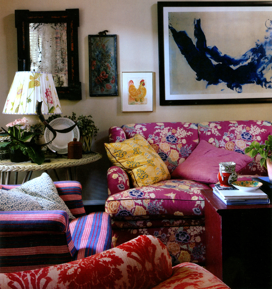 China Seas Macao II sofa and Quadrille Fairie Enchatee pillow by Jeffrey Bilhuber