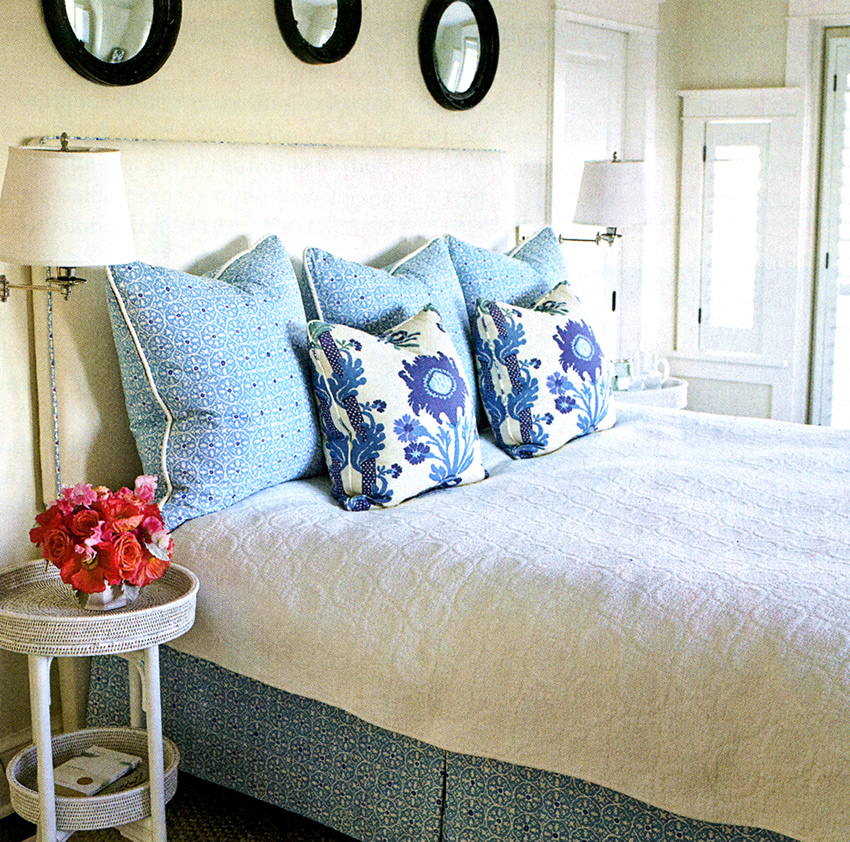 China Seas Nitik II bed skirt with Quadrille Henriot Floral pillows by Whitney Cutler